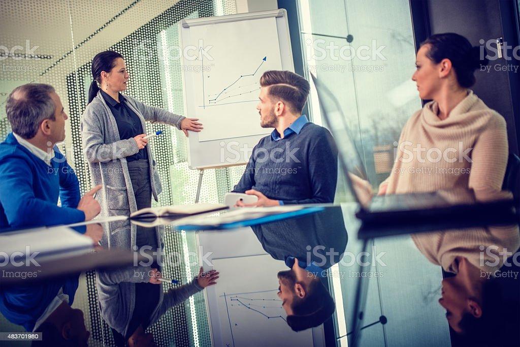 Female Executive Explaining Graph stock photo