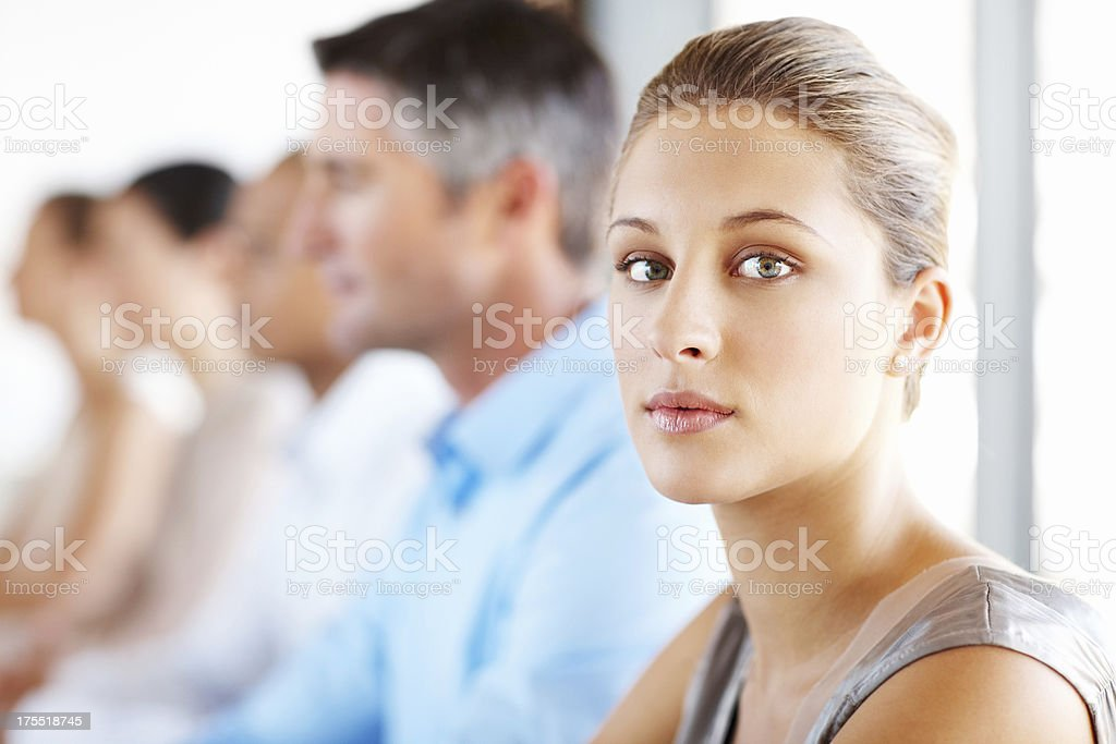 Female Executive In Staff Meeting royalty-free stock photo