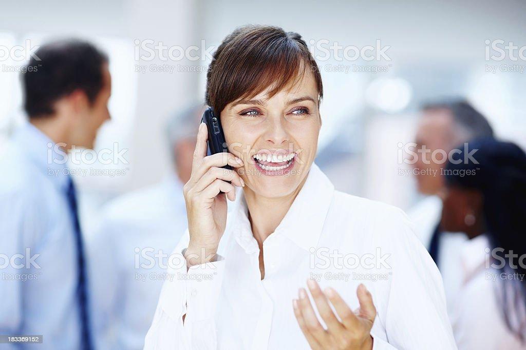 Female executive laughing on phone royalty-free stock photo