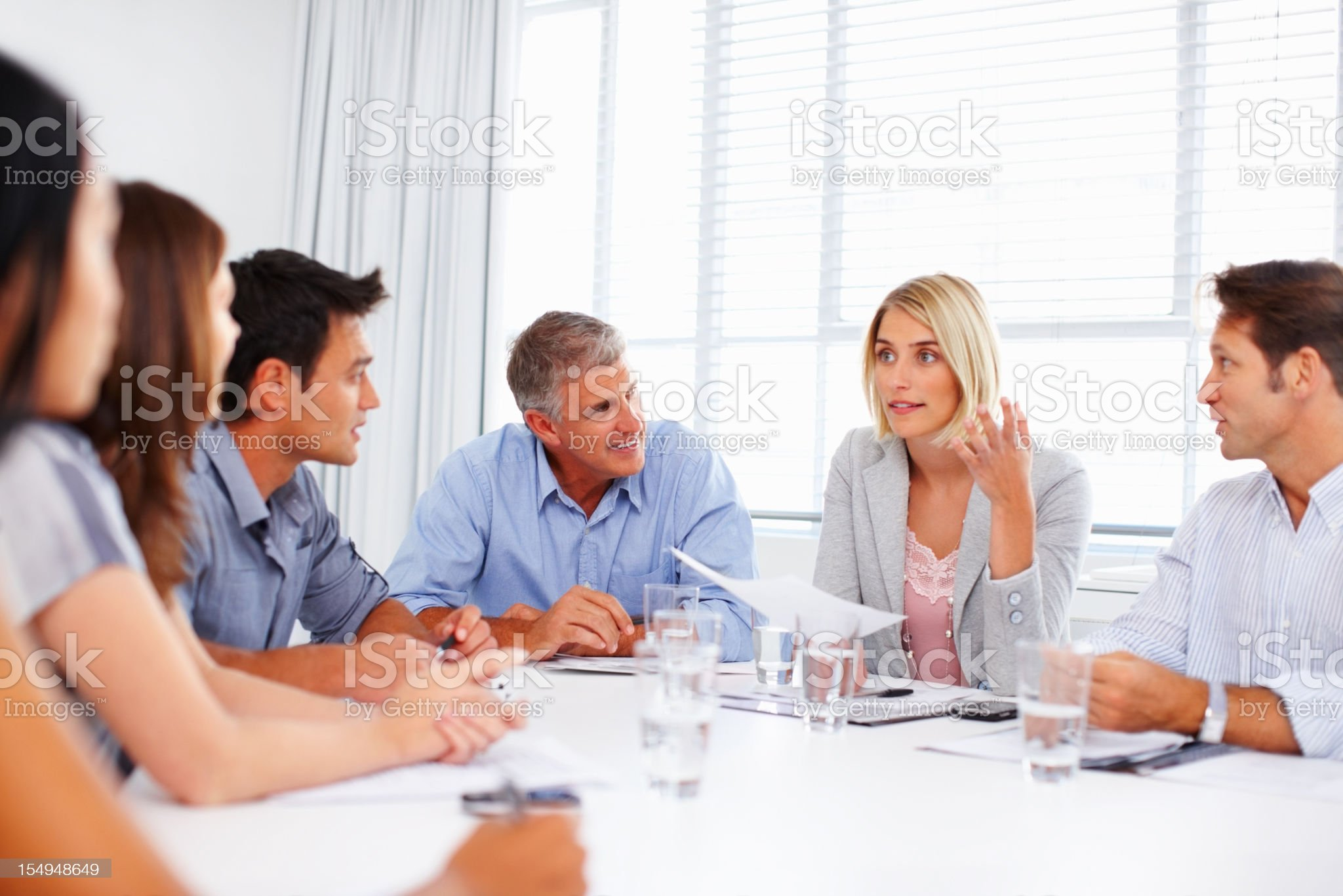 Female executive making a point in meeting royalty-free stock photo