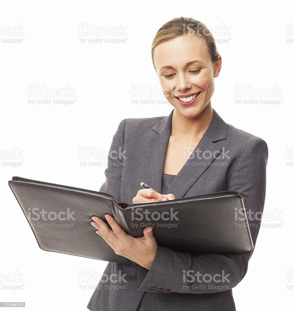 Female Executive Signing Document - Isolated royalty-free stock photo