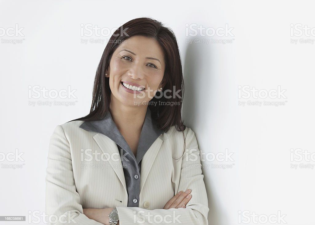Female Executive Standing With Arms Crossed stock photo