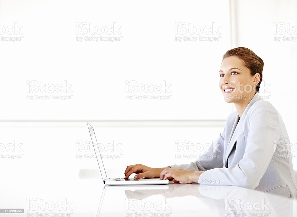 Female Executive Using Laptop In Office stock photo