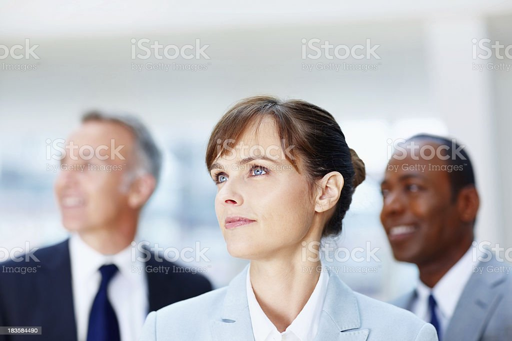 Female executive with colleagues in background royalty-free stock photo