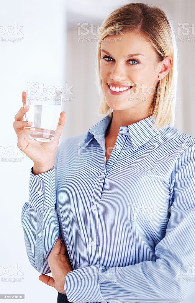 Female executive with glass of water stock photo