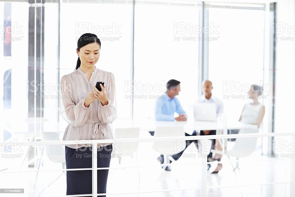 Female Executive With Mobile Phone stock photo