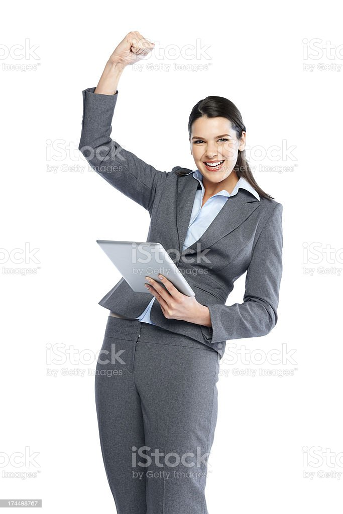 Female executive with tablet PC expressing her success royalty-free stock photo