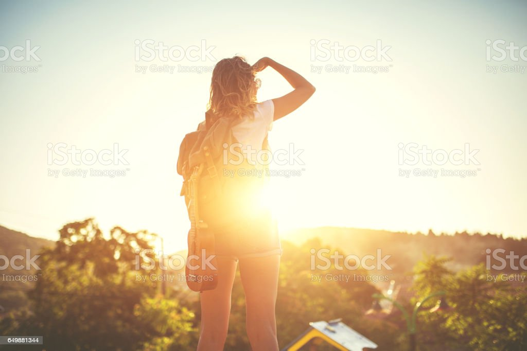 Female explorer looking for the right way stock photo