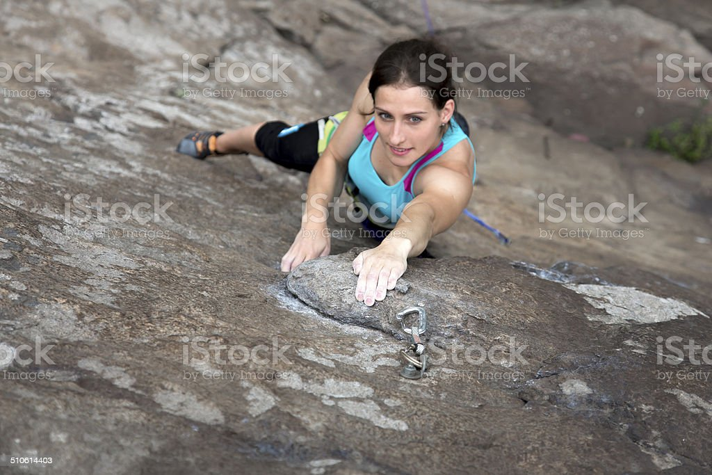 Female extreme climber from top stock photo