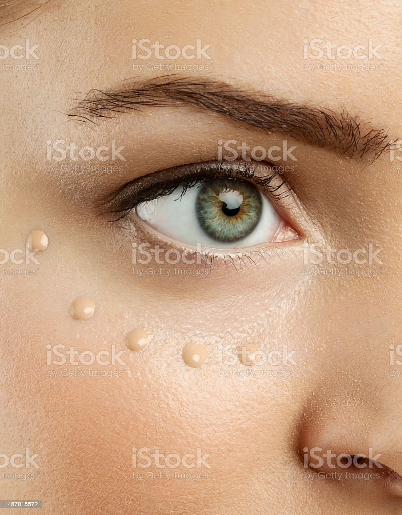 Female eye with applied eye cream stock photo