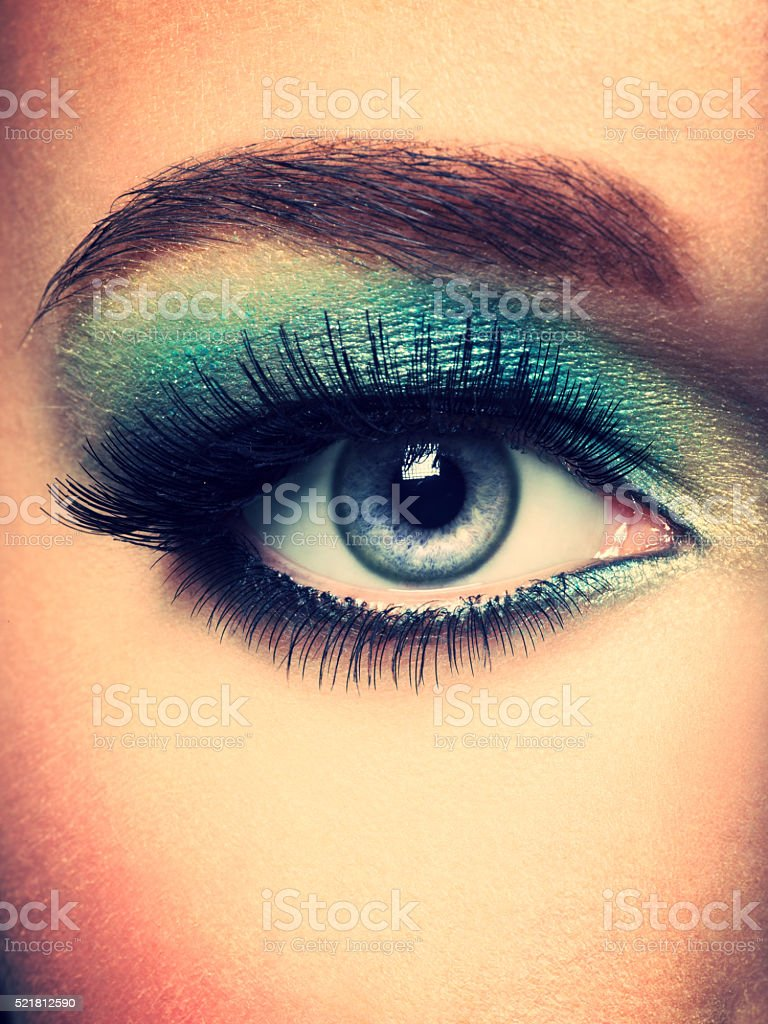 Female eye with green make-up. Long eyelashes stock photo