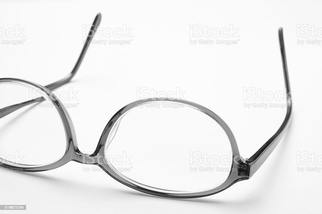Female eyeglasses macro detail over a white background stock photo