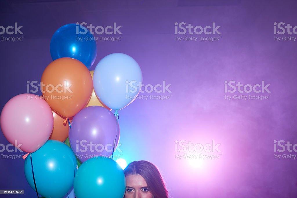Female eyes, balloons, disco lights stock photo