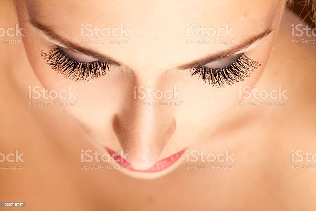 Female face and eyes with false eyelashes stock photo