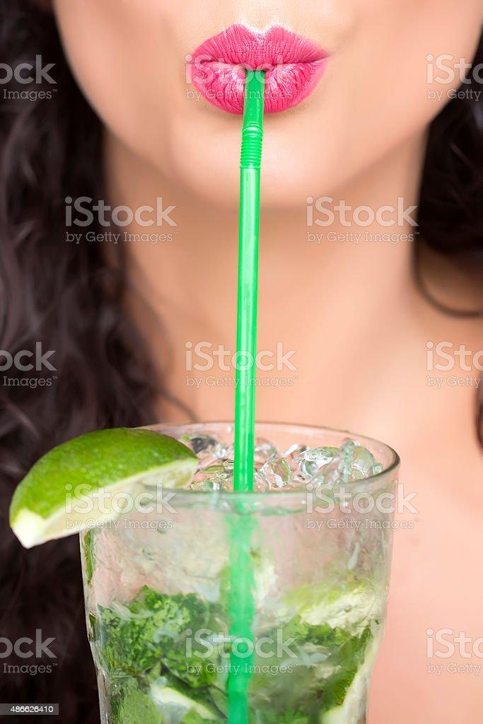 Female face and mojito stock photo