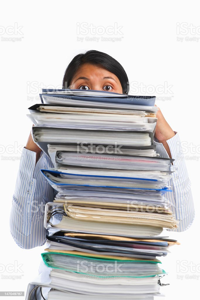 Female face behind pile of paper royalty-free stock photo