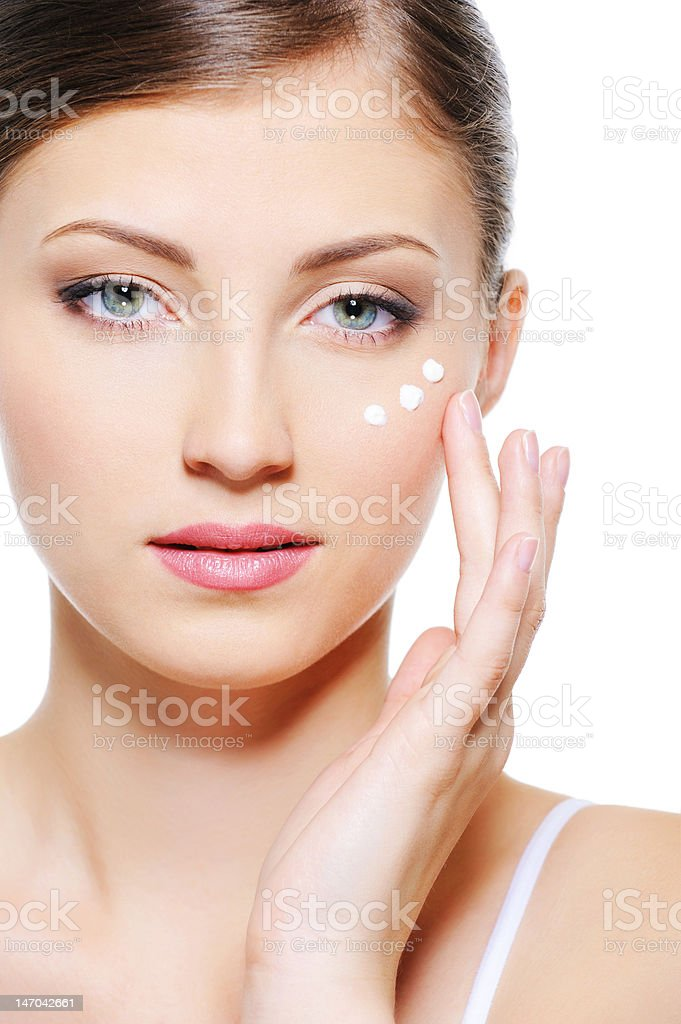 female face with a  moisturizer cream royalty-free stock photo
