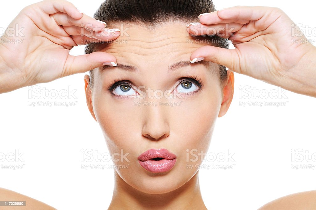 female face with wrinkles on her forehead stock photo