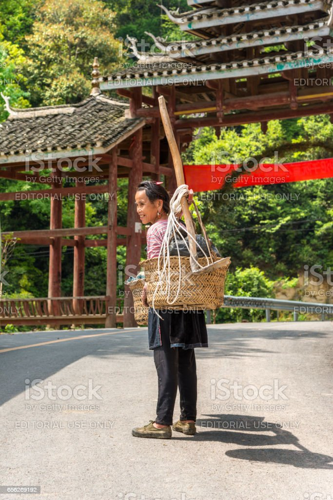 female farmer returning home near Huang Gang, China stock photo