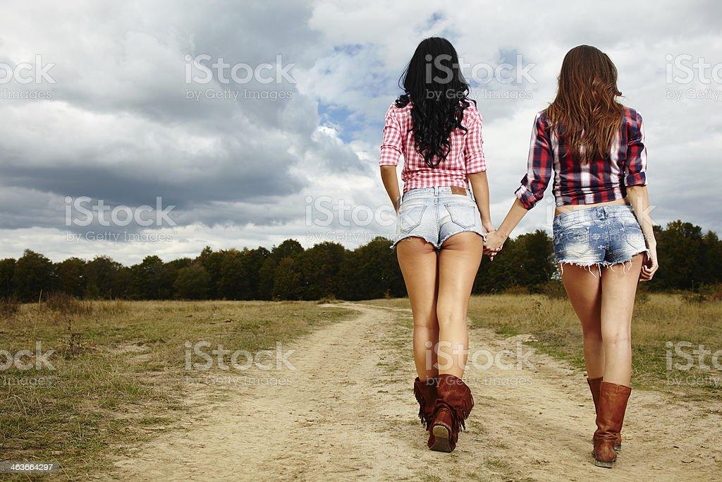 Female farmers walking in the countryside stock photo