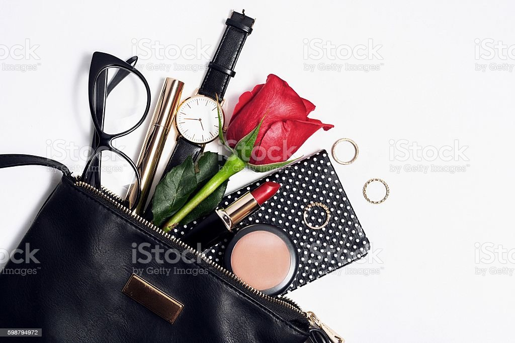 Female fashion accessories in black cosmetic bag. stock photo