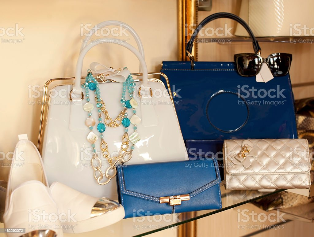 Female fashion accessories in blue and beige stock photo