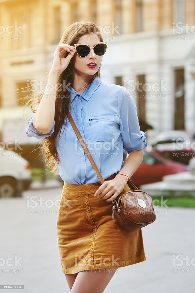 Female fashion concept. Outdoor portrait of young beautiful confident lady stock photo