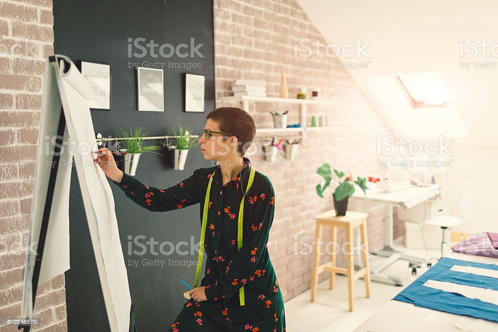 Female Fashion Designer Drawing stock photo