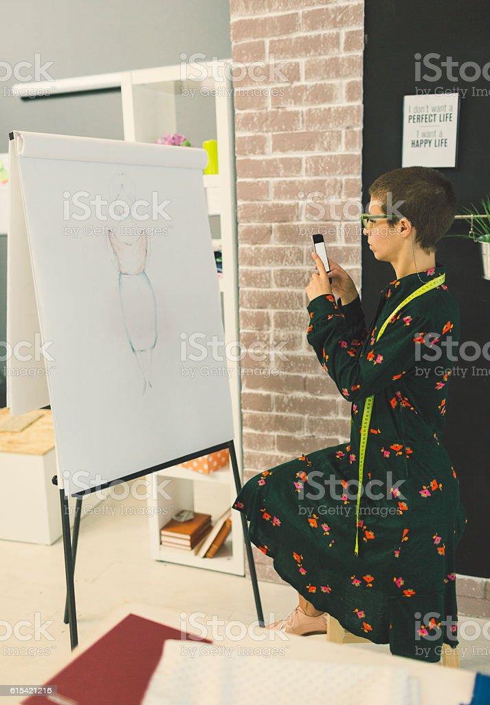 Female Fashion Designer In Her Workshop. stock photo