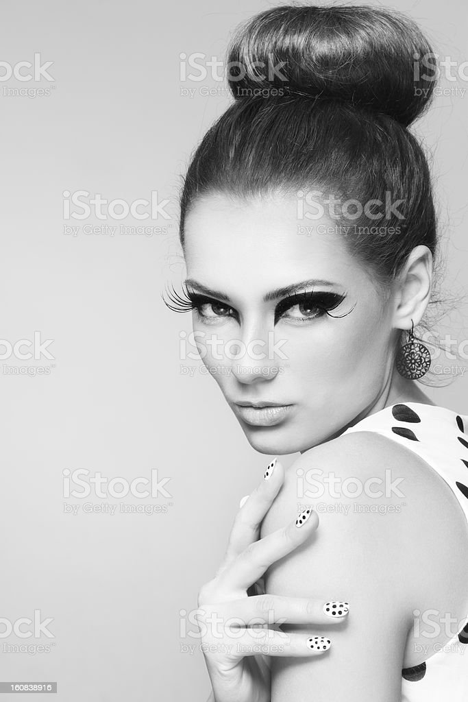Female fashion model with false eyelashes in black and white stock photo