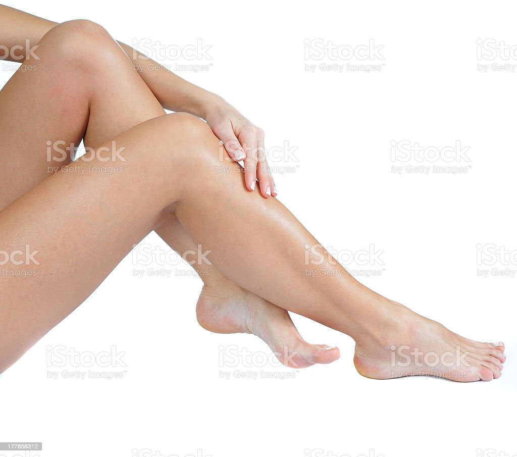 Female feet and legs with smooth skin on isolated background stock photo