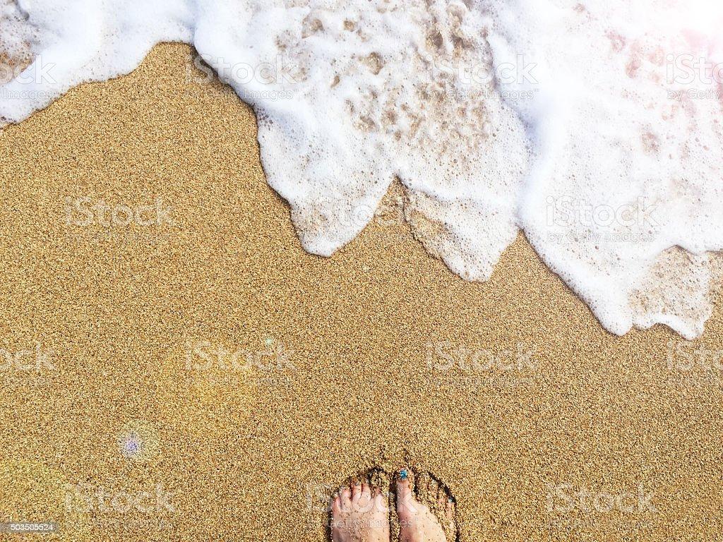 Female feet in sand on a golden beach, Kauai, Hawaii stock photo