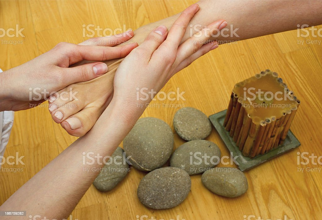 female feet on massage spa treatment royalty-free stock photo