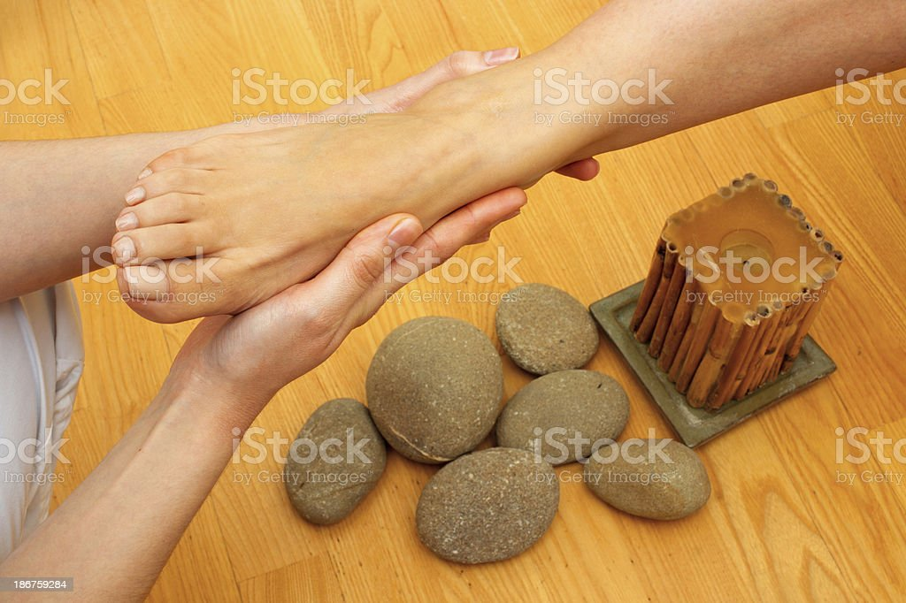 female feet on massage spa treatment royalty-free stock photo