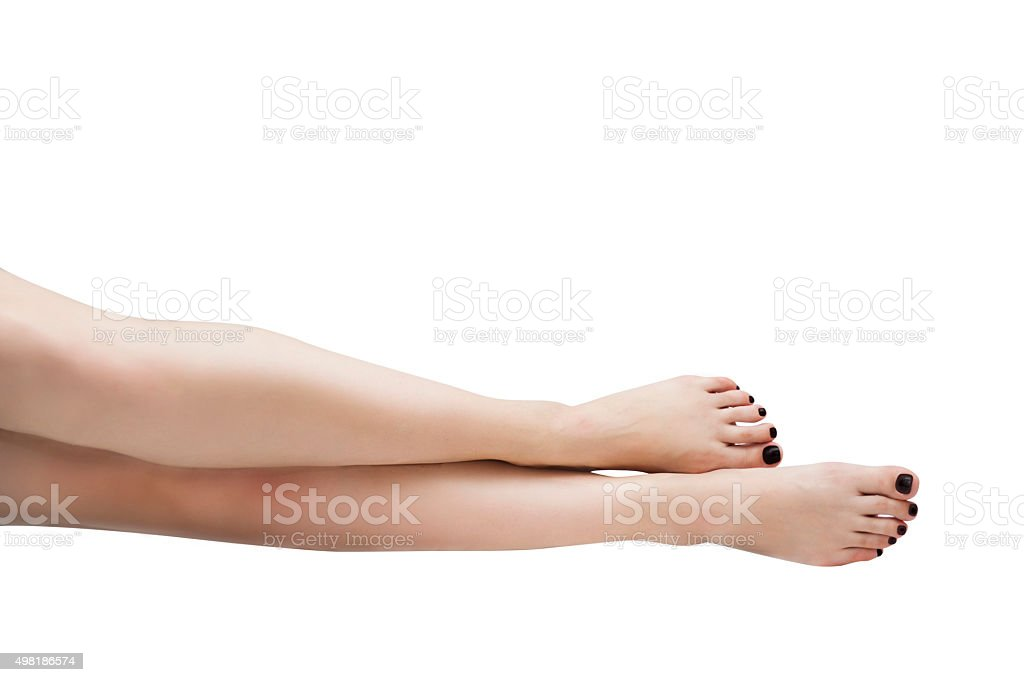 female feet with painted nails stock photo