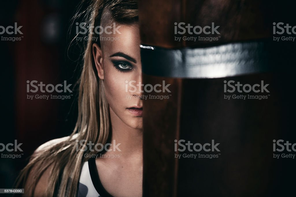 Female figher by a punching bag stock photo