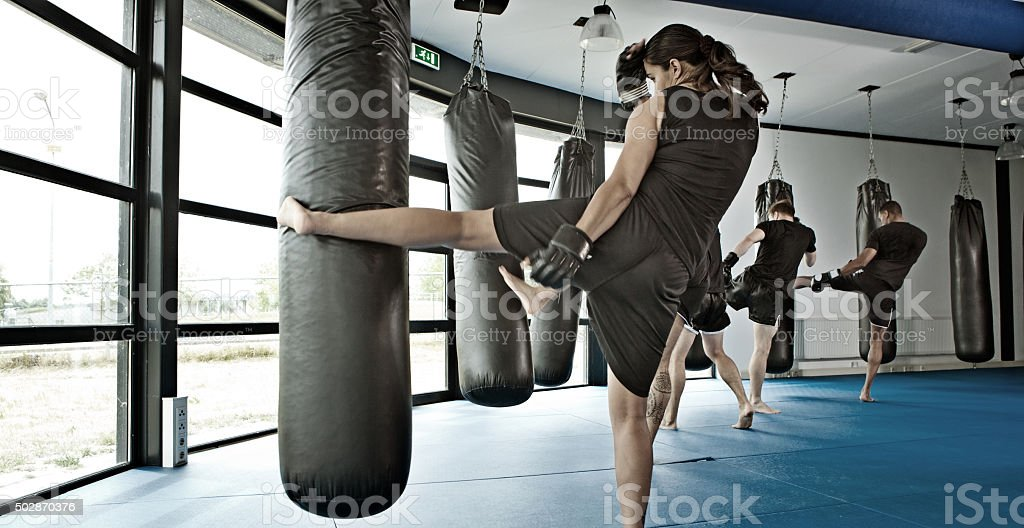 Female fighter during training session stock photo