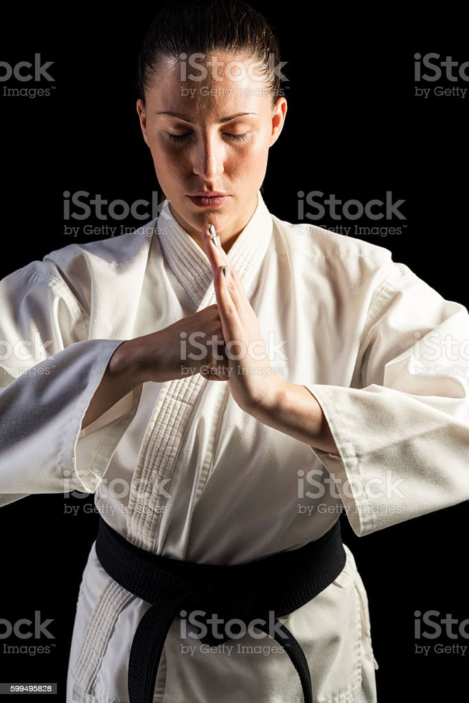 Female fighter performing hand salute stock photo