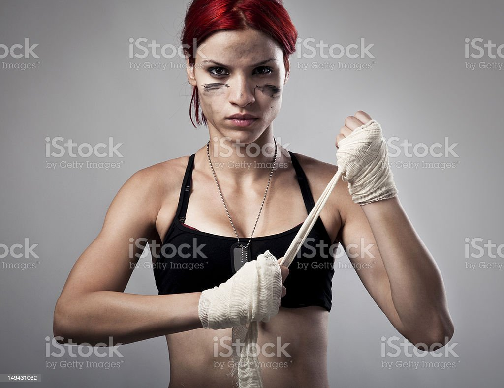 Female fighter, preparing for fight royalty-free stock photo