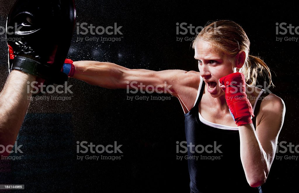 Female Fighter Throwing A Punch royalty-free stock photo