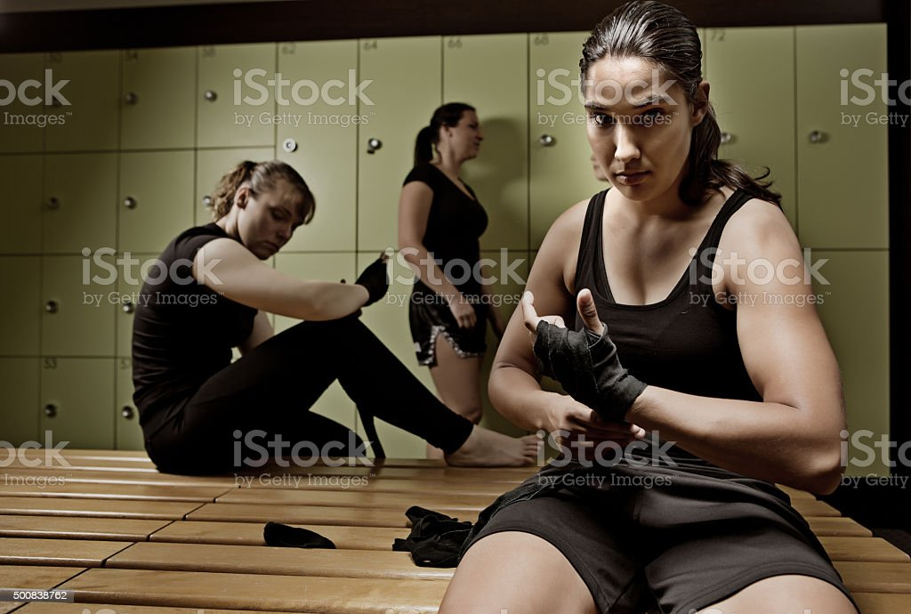 Female fighters preparing for training session stock photo