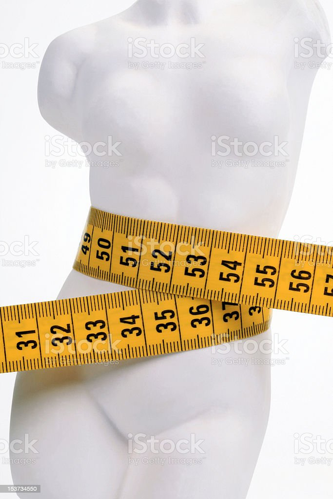 Female figure with a yellow measuring tape royalty-free stock photo