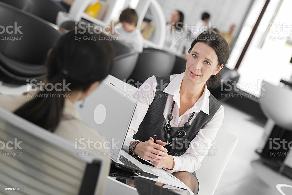 Female Financial Advisor Talking With Her Client royalty-free stock photo