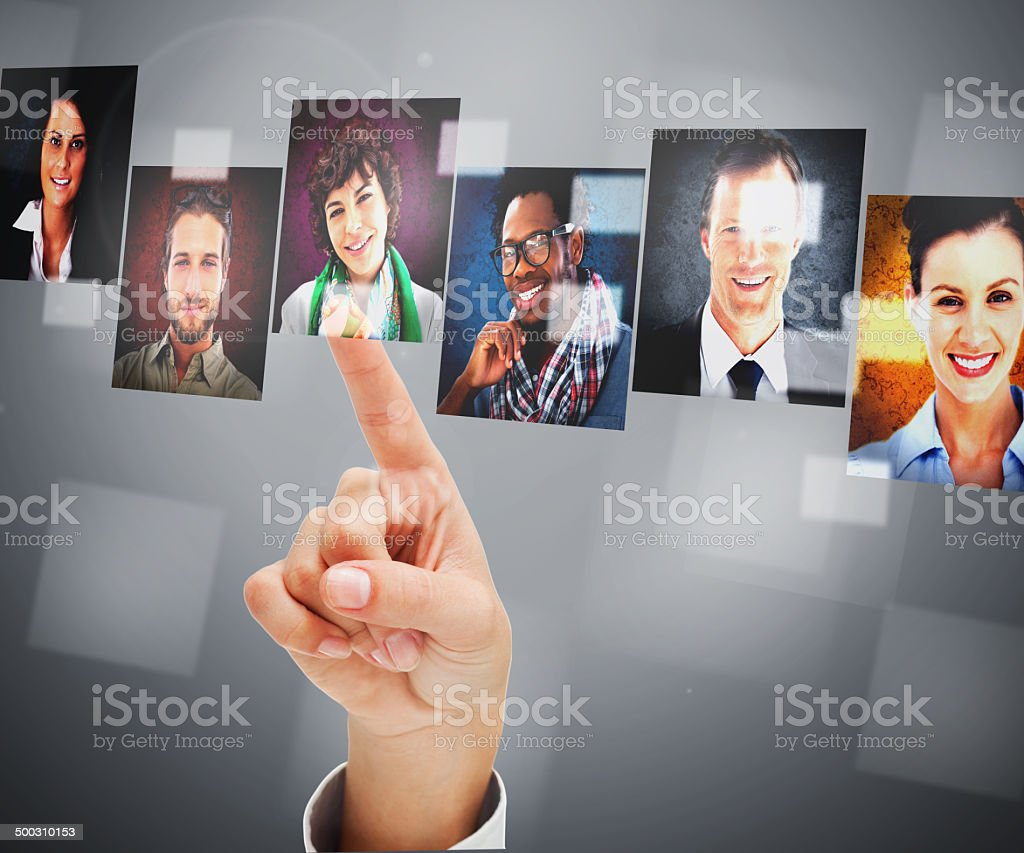 Female finger pointing at digital interface stock photo