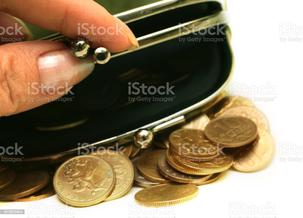 Female fingers open a purse with Russian coins stock photo