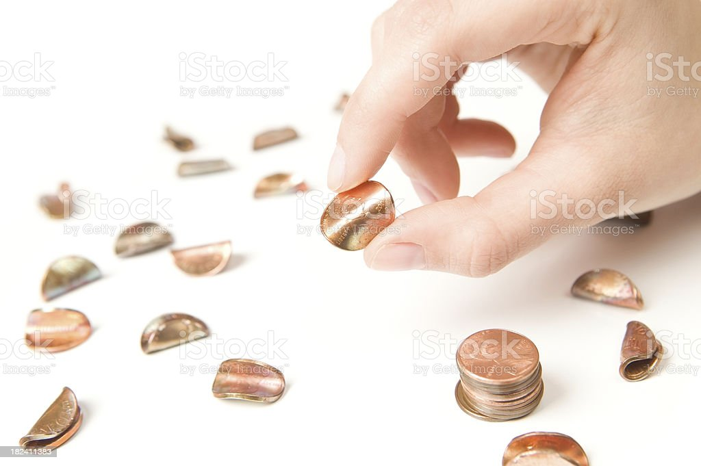 Female Fingers Pinching and Bending a Penny stock photo