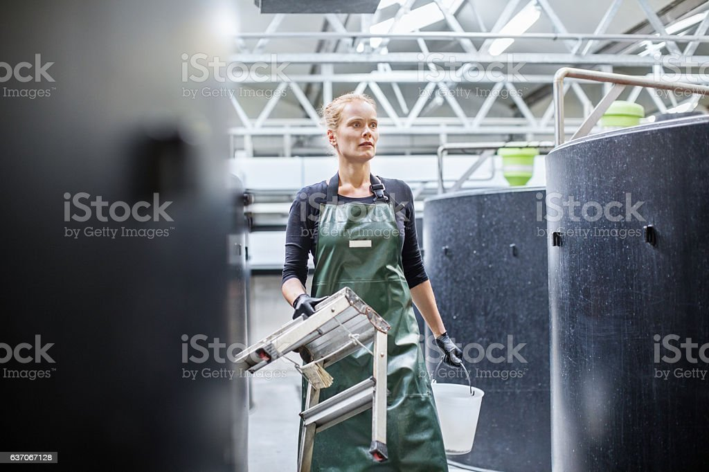 Female fish farm worker stock photo