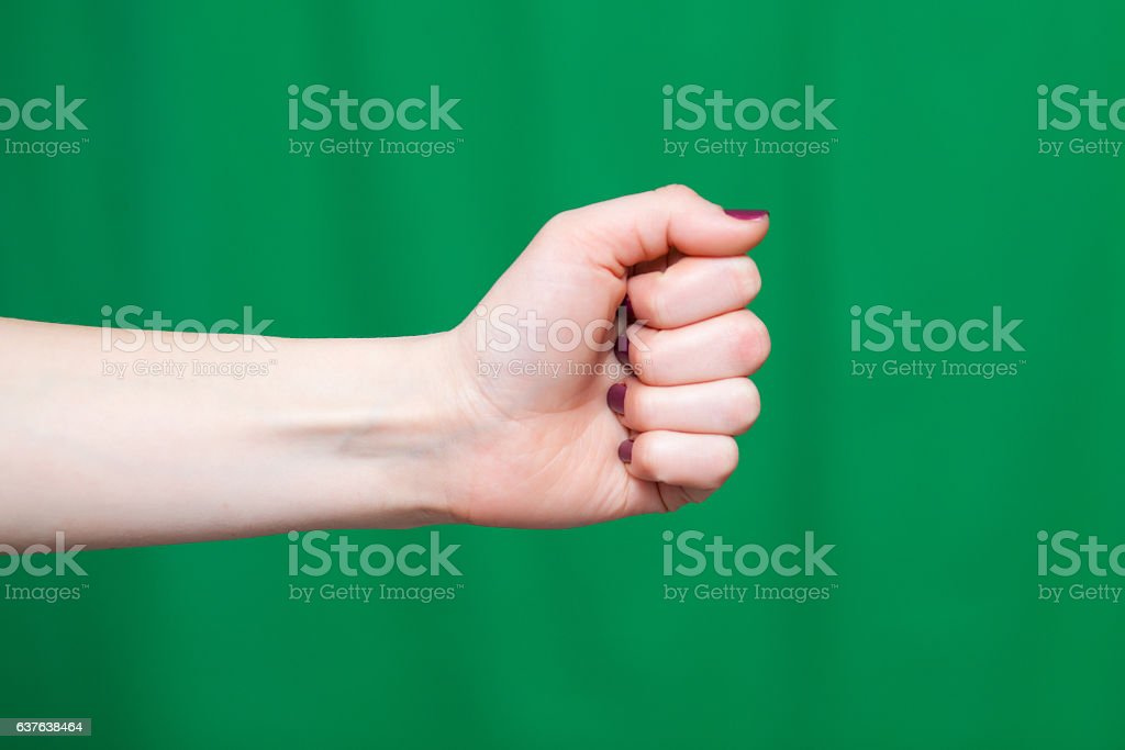 Female fist green background stock photo