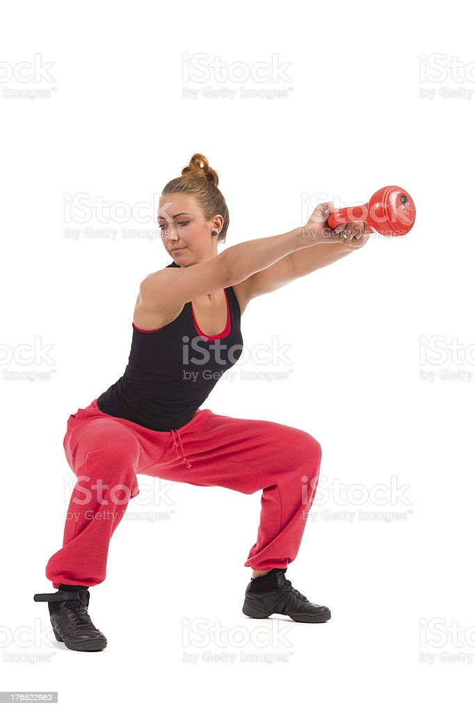 Female Fitness Instructor Exercise with Kettlebell royalty-free stock photo