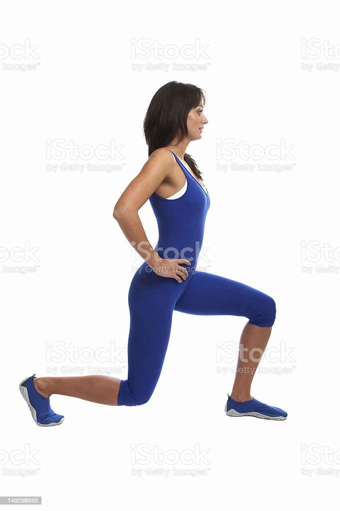 A female fitness instructor shows an exercise stock photo